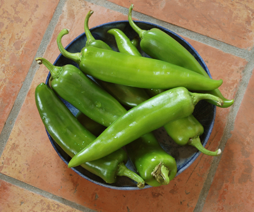 2 Green Chiles in Bowl on Tiles