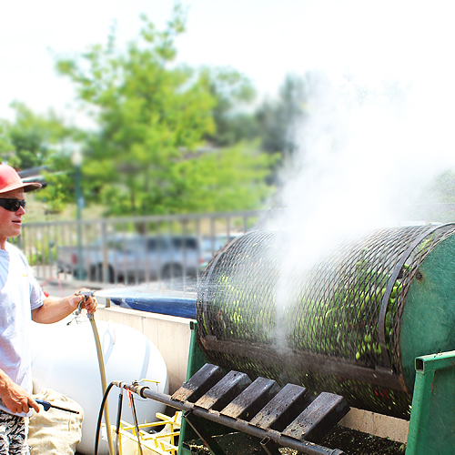 Spraying Chiles for Roasting